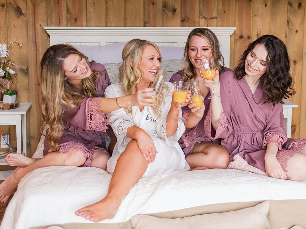West Virginia bride and bridesmaids enjoying cocktails before a wedding. Photographed by Katelyn Workman Photography.